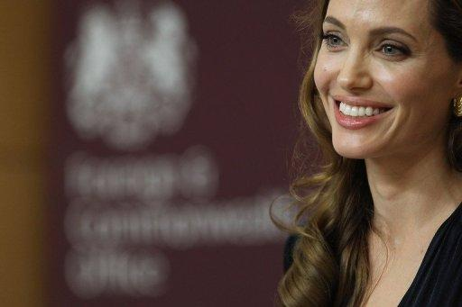 Actress Angelina Jolie speaks ahead of a screening of her new film 'In the Land of Blood and Honey' in London on May 29. Thousands of VIPs including some 120 national leaders will jet into London for Friday's Olympic opening ceremony, with guests ranging from Jolie to the king of Swaziland