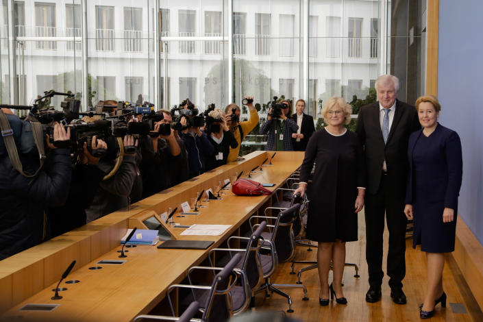 German Interior Minister Horst Seehofer, center, German Justice Minister Christine Lambrecht, left, and German Minister for Family Affairs, Senior Citizens, Women and Youth, Franziska Giffey, right, arrive for a news conference in Berlin, Germany, Wednesday, Oct. 30, 2019 on a package of measures against far-right extremism and anti-Semitism. Chancellor Angela Merkel's Cabinet signed off Wednesday on the tightening of gun laws, stricter persecution of hate crime online, and more financial support for initiatives fighting anti-Semitism and far-right extremism. (AP Photo/Markus Schreiber)