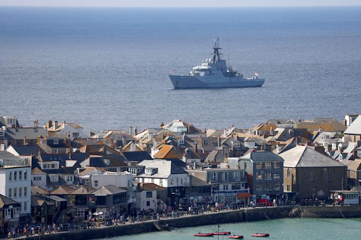 A royal navy vessel provides security for the G7 summit in the Cornish beach resort of Carbis Bay (Reuters)