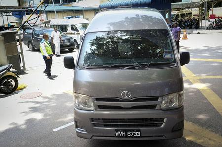 A van believed to be carrying the body of Kim Jong Nam, leaves the Kuala Lumpur Hospital.  Kyodo/via REUTERS