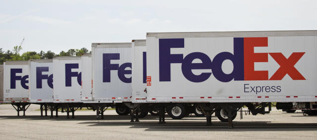 FedEx Express trucks sit idle at Richmond International Airport in Sandston, Va. (AP Photo/Steve Helber)