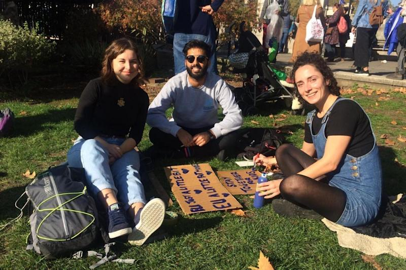Dolores Ehelihe, 29, Taha Abrar, 25 and Sarah-Jane Gay (L-R) made their own signs for the march