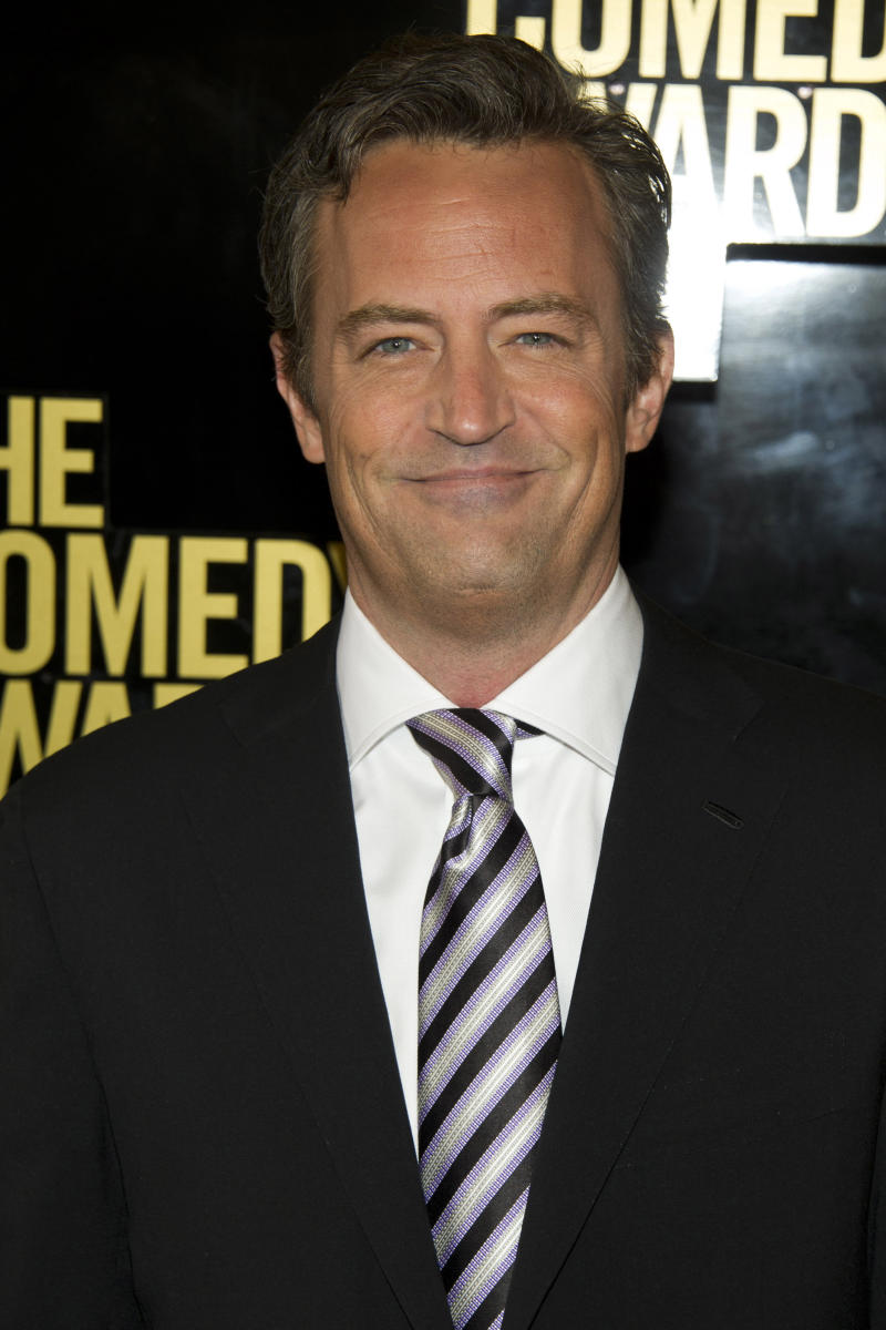 """FILE - In this April 28, 2012 file photo, Matthew Perry arrives to The 2012 Comedy Awards in New York. Hoping to lure viewers with laughs, struggling NBC is calling on old friend Matthew Perry to lend a hand. The TV network unveiled a fall schedule on Sunday that has 10 sitcoms, double the number of dramas it will air, including """"Go On,"""" starring Perry as a fast-talking, sarcastic sportscaster who loses his wife in a car accident. (AP Photo/Charles Sykes, File)"""