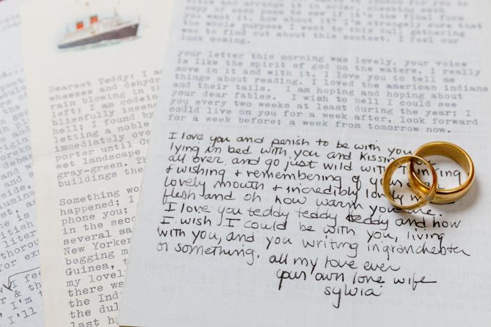 Notes written by Sylvia Plath to her husband, Ted Hughes, along with their matching gold wedding bands (PA)