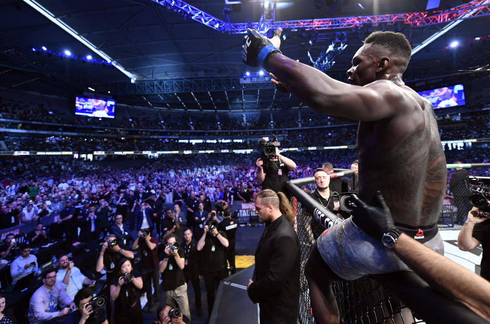 MELBOURNE, AUSTRALIA - OCTOBER 06:  Israel Adesanya of Nigeria celebrates after his knockout victory over Robert Whittaker of New Zealand in their UFC middleweight championship fight during the UFC 243 event at Marvel Stadium on October 06, 2019 in Melbourne, Australia. (Photo by Jeff Bottari/Zuffa LLC/Zuffa LLC via Getty Images)