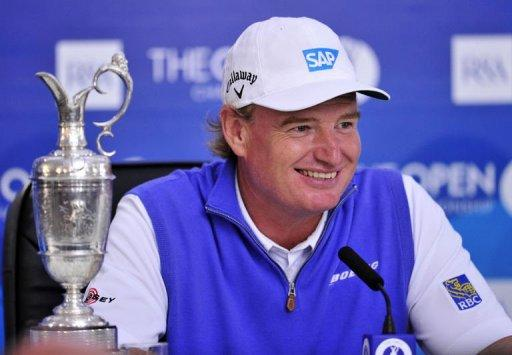 Ernie Els of South Africa smiles next to the Claret Jug