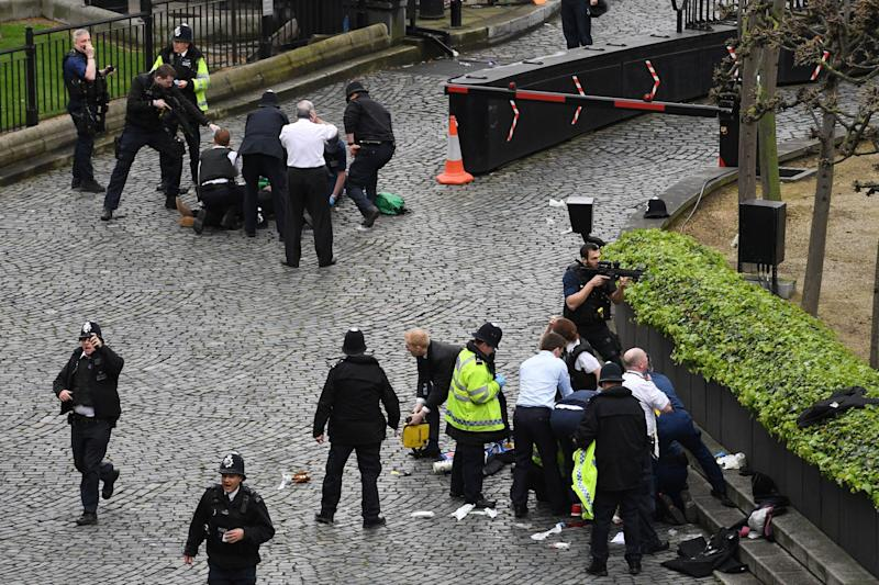 Emergency services at the scene outside the Palace of Westminster after policeman Keith Palmer was stabbed and his attacker shot - Credit: PA