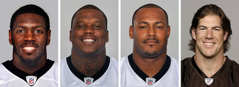 FILE - From left are NFL football players Jonathan Vilma, in 2011; Anthony Hargrove, in 2010; Will Smith, in 2011; and Scott Fujita, in 2011. The suspensions of four players in the NFL's bounty investigation have been lifted by a three-member appeals panel. The league reinstated those players a few minutes after Friday's, Sept. 7, 2012 ruling. While the ruling allows Saints linebacker Jonathan Vilma, Saints defensive end Will Smith, Cleveland linebacker Scott Fujita and free agent defensive lineman Anthony Hargrove to play immediately, it does not permanently void their suspensions (AP Photo/File)