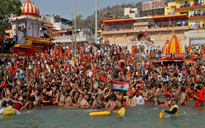 "Hindu devotees take a holy dip in the Ganges River during Shahi Snan at ""Kumbh Mela"", or the Pitcher Festival, in Haridwar, India - Anushree Fadnavis/REUTERS"