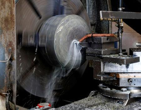 Granite is shaped on a lathe to make a curling stone in Kays Factory Mauchline, Scotland, Britain, January 11, 2018. REUTERS/Russell Cheyne