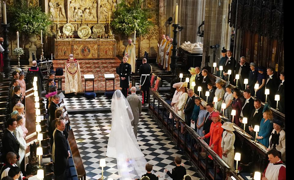 WINDSOR, UNITED KINGDOM - MAY 19:  Prince Harry looks at his bride, Meghan Markle, as she arrived accompanied by Prince Charles, Prince of Wales during their wedding in St George's Chapel at Windsor Castle on May 19, 2018 in Windsor, England. (Photo by Owen Humphreys - WPA Pool/Getty Images)