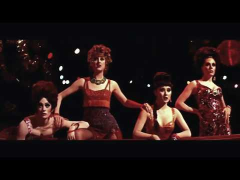 "<p>The show opens on the filming of ""Big Spender"" from Bob Fosse's 1969 film <em>Sweet Charity</em>. In the original version, of course, we're not treated to <a href=""https://www.townandcountrymag.com/leisure/arts-and-culture/a27092135/michelle-williams-liza-minnelli-cabaret-fosse-verdon-comment/"" rel=""nofollow noopener"" target=""_blank"" data-ylk=""slk:Gwen Verdon"" class=""link rapid-noclick-resp"">Gwen Verdon</a> (Michelle Williams) and Fosse (Sam Rockwell)'s behind-the-scenes commentary and direction-but aside from that, <em>Fosse/Verdon</em> recreated ""Big Spender"" as accurately as possible.</p><p><a href=""https://www.youtube.com/watch?v=_SmU50xSrRs"" rel=""nofollow noopener"" target=""_blank"" data-ylk=""slk:See the original post on Youtube"" class=""link rapid-noclick-resp"">See the original post on Youtube</a></p>"