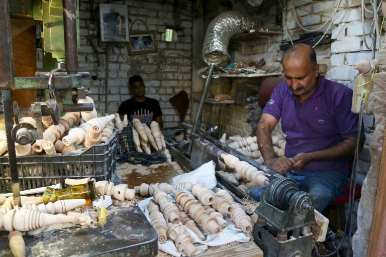 Orders for Karbala's wooden pipes for shishas come from as far away as Germany, helping the carpenters survive the economic crisis caused by Covid-19 when smoking cafes were closed