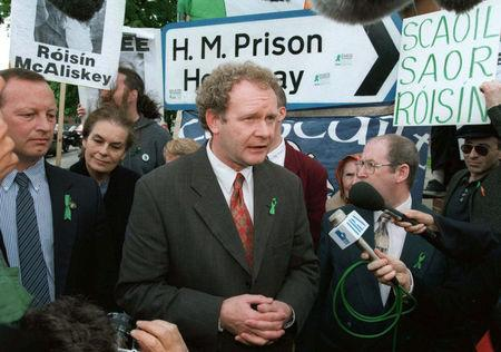 FILE PHOTO: Sinn Fein member of parliament Martin McGuinness speaks to the media outside Holloway Prison, in London, Britain May 13, 1997. REUTERS/Paul Hackett/File Photo