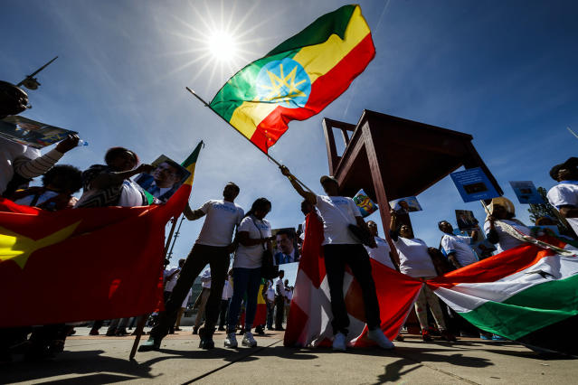 <p>People wave flags and banners in support of Tedros Adhanom Ghebreyesus of Ethiopia, candidate to the position of Director General of the World Health Organization (WHO), in front of the European headquarters of the United Nations in Geneva, Switzerland, May 23, 2017. (Photo: Valentin Flauraud/EPA) </p>