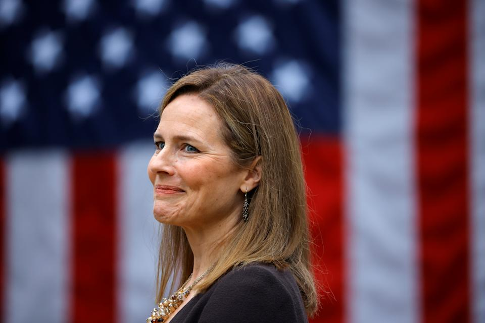 U.S. Court of Appeals for the Seventh Circuit Judge Amy Coney Barrett reacts as U.S President Donald Trump holds an event to announce her as his nominee to fill the Supreme Court seat left vacant by the death of Justice Ruth Bader Ginsburg, who died on September 18, at the White House in Washington, U.S., September 26, 2020. REUTERS/Carlos Barria TPX IMAGES OF THE DAY