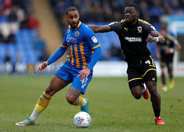 "Soccer Football - League One - Shrewsbury Town vs AFC Wimbledon - Montgomery Waters Meadow, Shrewsbury, Britain - March 24, 2018 Shrewsbury Town's Stefan Payne in action with AFC Wimbledon's Deji Oshilaja Action Images/Ed Sykes EDITORIAL USE ONLY. No use with unauthorized audio, video, data, fixture lists, club/league logos or ""live"" services. Online in-match use limited to 75 images, no video emulation. No use in betting, games or single club/league/player publications. Please contact your account representative for further details."