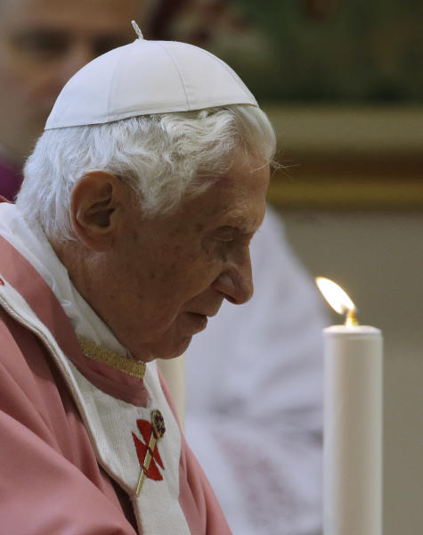 Pope Benedict XVI arrives at the St. Patrick church to celebrate a mass in Rome, Sunday, Dec. 16, 2012. (AP Photo/Gregorio Borgia)