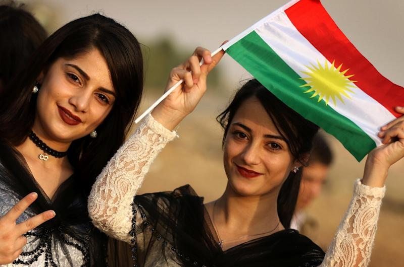 Iranian Kurdish girls take part in a rally to urge people to vote in next week's independence referendum in the Iraqi Kurdish region on September 21, 2017