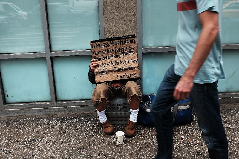 A homeless man panhandles along Eighth Avenue in Manhattan on May 18, 2015 in New York City (AFP Photo/Spencer Platt)