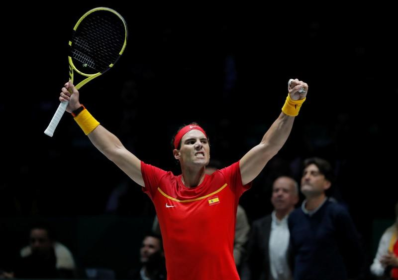 Nadal sparks Spanish comeback, Canada into last eight