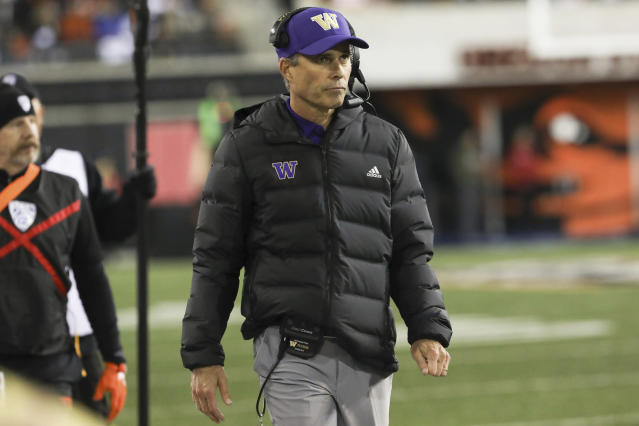 Washington head coach Chris Petersen watches the scoreboard during the first half of an NCAA college football game against Oregon State in Corvallis, Ore., Friday, Nov. 8, 2019. Washington won 19-7. (AP Photo/Amanda Loman)