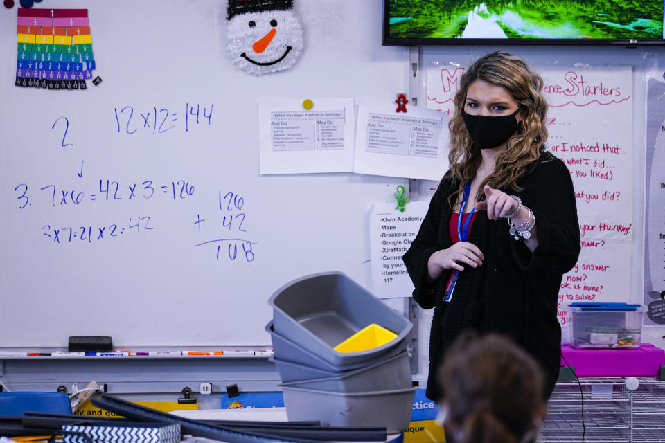 Grace Kern, a substitute teacher at the Greenfield Intermediate School in Greenfield, Ind., is photographed Thursday, Dec. 10, 2020. Kern, astudent at IUPUI in Indianapolis, is one of several college students being recruited to work as substitute teachers in schools during the pandemic. (AP Photo/Michael Conroy)