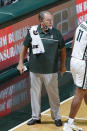 Michigan State coach Tom Izzo stands on the court during the second half of the team's NCAA college basketball game against Eastern Michigan, Wednesday, Nov. 25, 2020, in East Lansing, Mich. (AP Photo/Al Goldis)