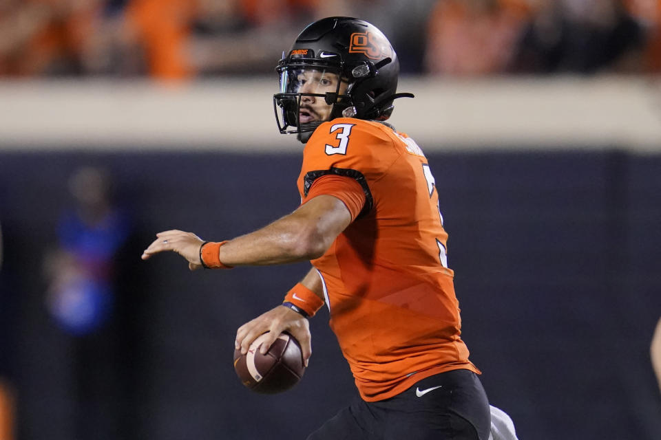 Oklahoma State quarterback Spencer Sanders (3) throws in the second half of an NCAA college football game against Baylor, Saturday, Oct. 2, 2021, in Stillwater, Okla. (AP Photo/Sue Ogrocki)