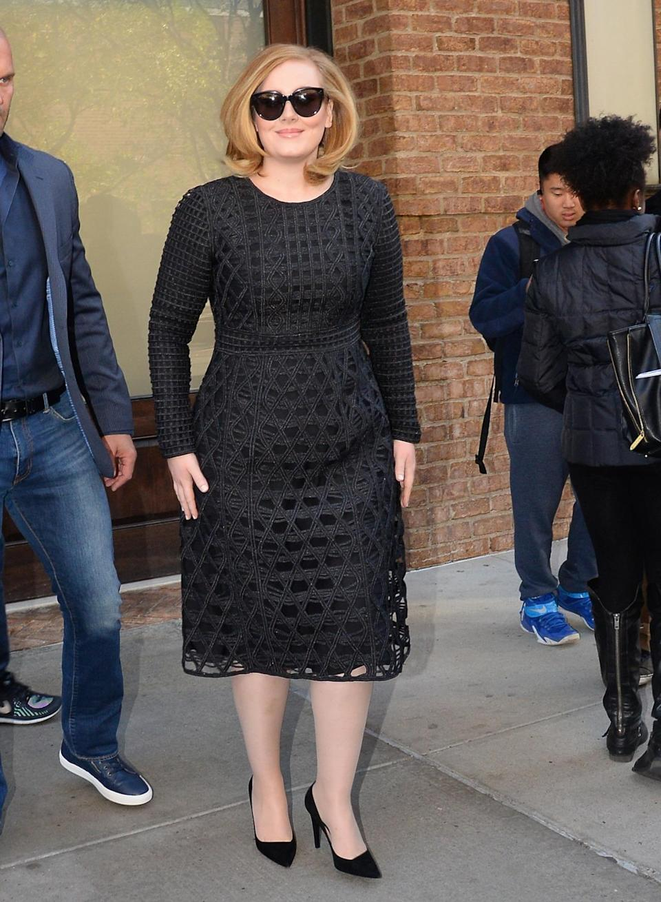 <p>Spotted on the streets of New York City, Adele stepped out looking like the megastar she is in a black lattice dress. Her hair was blown out with a little bounce and she covered her eyes, which were most likely adorned with cateye makeup, with cateye sunglasses. <i>Photo: Getty Images</i></p>