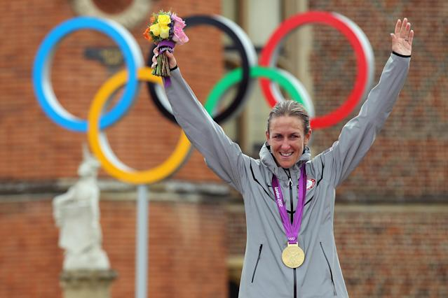 LONDON, ENGLAND - AUGUST 01: Gold medallist Kristin Armstrong of the United State celebrates during the medal ceremony after the Women's Individual Time Trial Road Cycling on day 5 of the London 2012 Olympic Games on August 1, 2012 in London, England. (Photo by Alex Livesey/Getty Images)
