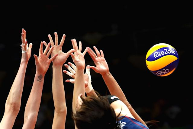 <p>Russian player block the ball during the Preliminary Pool A match between South Korea and Russia on Day 3 of the Rio 2016 Olympic Games at the Maracanazinho on August 8, 2016 in Rio de Janeiro, Brazil. (Photo by Cameron Spencer/Getty Images) </p>