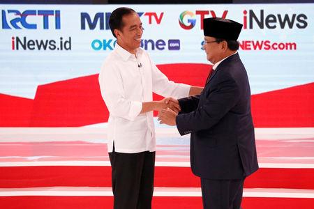 Indonesia's presidential candidate Joko Widodo (L) shakes hands with his opponent Prabowo Subianto after the second debate between presidential candidates ahead of the next general election in Jakarta, Indonesia, February 17, 2019. REUTERS/Willy Kurniawan