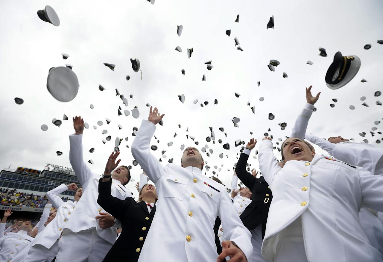 Members of the 2013 graduating class of the United States Naval Academy throw their caps into the air marking the end of their commencement ceremony in Annapolis, Md,. Friday, May 24, 2013, where President Barack Obama spoke. (AP Photo/Pablo Martinez Monsivais)