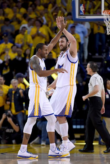 OAKLAND, CA - MAY 13: Andre Iguodala #9 of the Golden State Warriors is congratulated by Andrew Bogut #12 during a time-out after Iguodala hit a three-point shot against the Memphis Grizzlies during Game Five of the Western Conference Semifinals of the NBA Playoffs at ORACLE Arena on May 13, 2015 in Oakland, California. NOTE TO USER: User expressly acknowledges and agrees that, by downloading and or using this photograph, User is consenting to the terms and conditions of the Getty Images License Agreement. (Photo by Thearon W. Henderson/Getty Images)