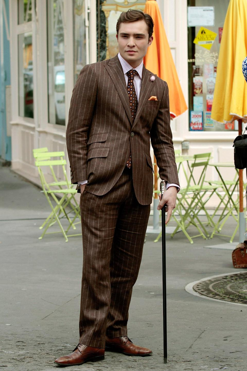 <p>How dapper does he look in this pinstripe Paul Stewart suit? Notice the pink boutonniere, too.</p>