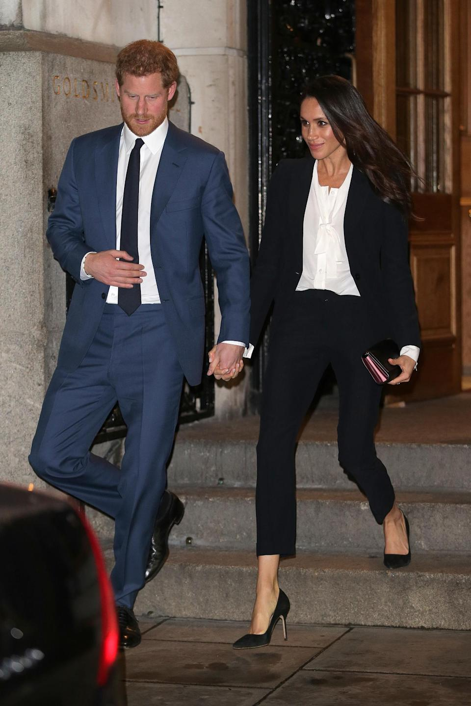 Prince Harry and Meghan Markle attend the Endeavour Awards 2018, the first time Markle wore her Alexander McQueen tuxedo (Getty Images)
