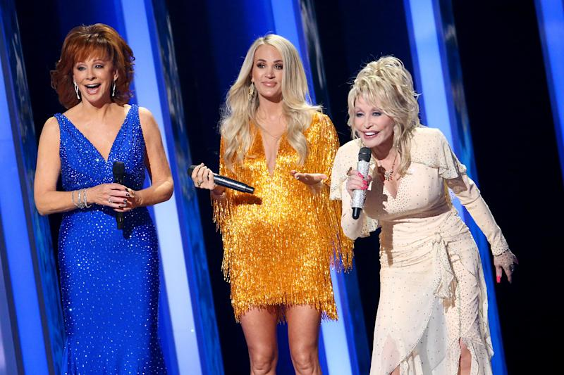 Dolly Parton on stage with Reba McEntire and Carrie Underwood