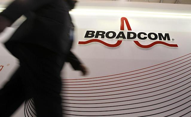 An attendee passes the Broadcom Corp. pavilon on day two of the Mobile World Congress in Barcelona. Photographer: Angel Navarrete