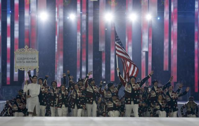 REFILE - CORRECTING TEAM U.S. Team flag-bearer Jon Lujan (C), leads his country's contingent during the opening ceremony of the 2014 Paralympic Winter Games in Sochi, March 7, 2014. REUTERS/Alexander Demianchuk (RUSSIA - Tags: OLYMPICS SPORT TPX IMAGES OF THE DAY)