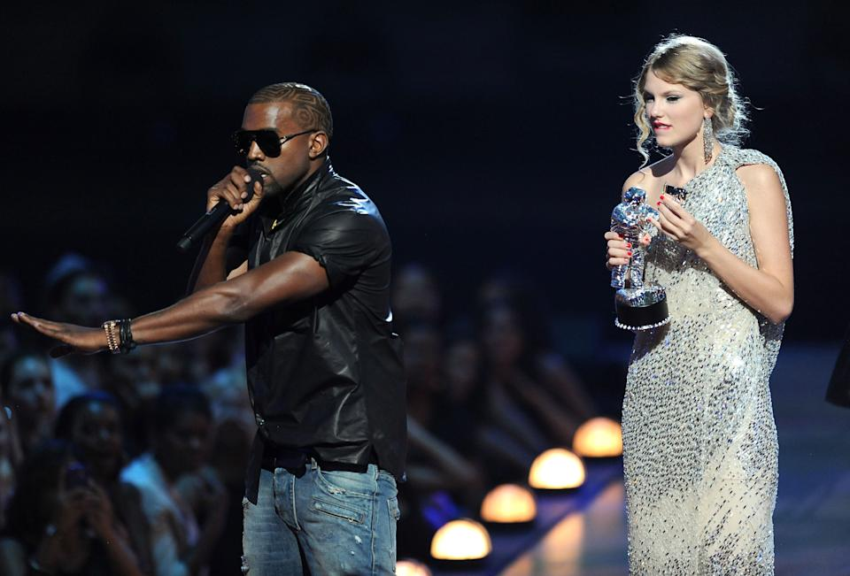 NEW YORK - SEPTEMBER 13:  Kanye West takes the microphone from Taylor Swift and speaks onstage during the 2009 MTV Video Music Awards at Radio City Music Hall on September 13, 2009 in New York City.  (Photo by Kevin Mazur/WireImage)