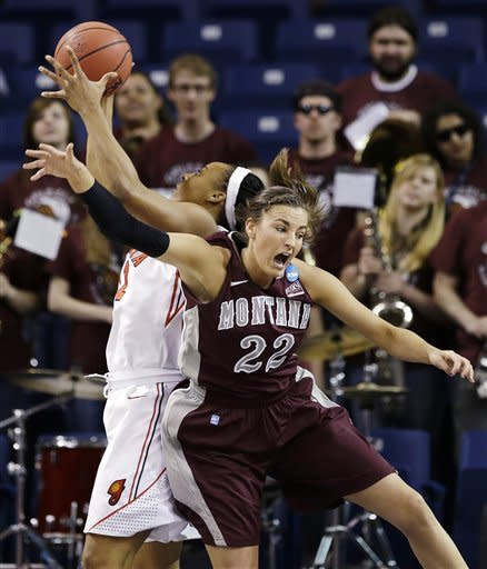 Montana's Katie Baker (22) collides with Georgia's Jasmine Hassell in the first half during a first-round game in the women's NCAA college basketball tournament in Spokane, Wash., Saturday, March 23, 2013. (AP Photo/Elaine Thompson)