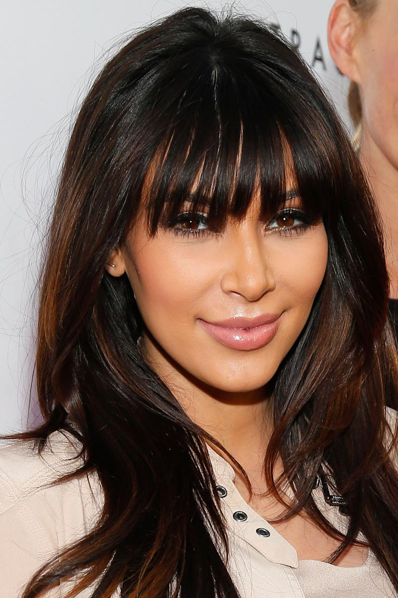BRENTWOOD, CA - APRIL 04: Television personality Kim Kardashian attends the opening of Tracy Anderson flagship studio at Tracy Anderson Flagship Studio on April 4, 2013 in Brentwood, California. (Photo by Imeh Akpanudosen/Getty Images)