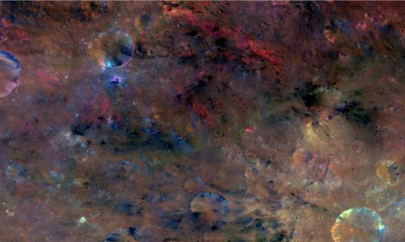 The northwest region of Vesta's crater Sextilia (at the bottom right of this image) reveals material likely carried in by an impact (black), as well as material that was probably created by melting (red).