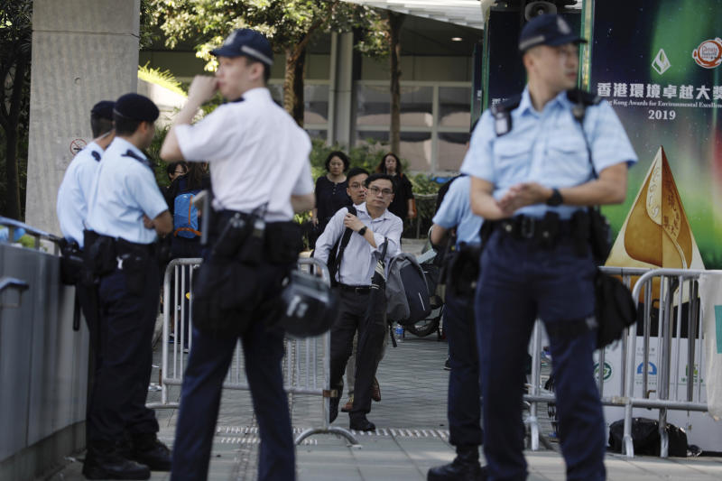 Police officers man a check point into the Legislative Council in Hong Kong on Friday, June 14, 2019. Calm appeared to have returned to Hong Kong after days of protests by students and human rights activists opposed to a bill that would allow suspects to be tried in mainland Chinese courts. (AP Photo/Vincent Yu)