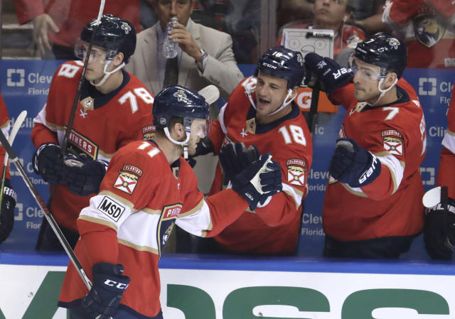 Florida Panthers' Jonathan Huberdeau, left, celebrates with Micheal Haley (18) and Colton Sceviour (7) after scoring a goal during the first period of an NHL hockey game against the Buffalo Sabres, Saturday, April 7, 2018, in Sunrise, Fla. (AP Photo/Lynne Sladky)