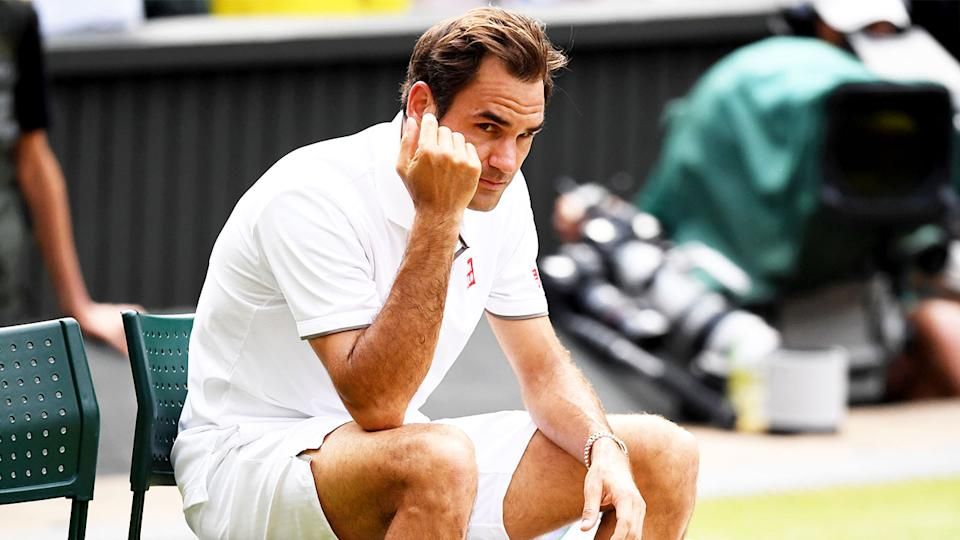 Roger Federer (pictured) sitting down devastated after the 2019 Wimbledon final loss.