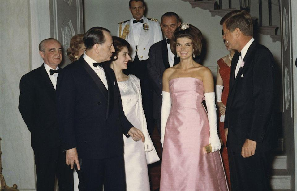 <p>The First Lady commands the room in a strapless silk gown, evening gloves, and a glittering hairpiece at a state dinner in honor of the Minister of State for Cultural Affairs of France. <br></p>