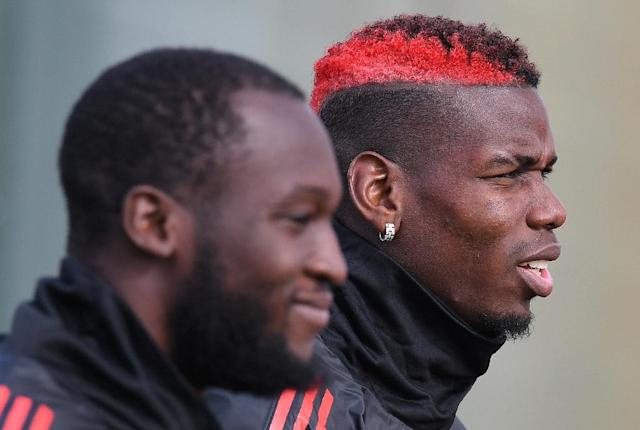 Romelu Lukaku (left) and Paul Pogba (right) were both dropped to the bench for Manchester United's clash with Arsenal on Wednesday (AFP Photo/Paul ELLIS)