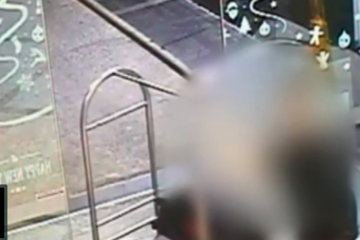Blurred CCTV footage of Grace Millane murder accused pushing a luggage trolley through a hotel lobby.